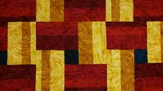 "love the ""cool"" blue centers for the ""hot"" red & yellow colors of this quilt!"