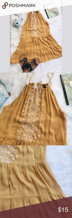 """Aeropostale Embroidered Keyhole Back Halter Dress ▪️Product Description▪️ ▫️Fun boho vibes with this mustard color beauty  ▫️Layered skirt with a drop waist  ▫️Self tied tasseled keyhole back  ▫️White embroidery with a tribal inspired design   ▪️Fit: true small, loose & flowy, tie must be adjusted to your best fit, recommended wear with a bralette or bandeau since side cleavage may show  ▪️Condition: NWOT (yellow is just not my color 🤷🏼♀️)  ▪️Measurements: Approx/Laying Flat  ▫️Chest- 17""""…"""