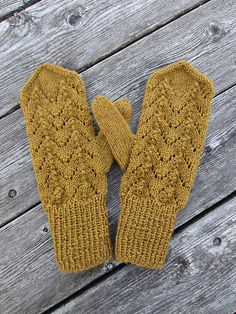 Simple little mittens with an easy lace pattern.