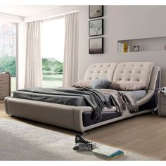 Update your bedroom with this contemporary bed. The unique, gently curved rails are upholstered in faux leather finished in light tan. The sturdy wood construction ensures that this elegant and sleek bed set lasts for years to come.