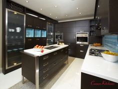 Dark oak cabinets in our Toronto showroom - modern, clean lines with slab doors and paneled appliances. Dark Oak Cabinets, Contemporary Kitchen Design, Luxury Kitchens, Custom Cabinets, Beautiful Kitchens, Slab Doors, Clean Lines, Showroom, Toronto