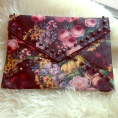 NWOT beautiful canvas rose clutch NWOT beautiful studded canvas rose clutch. Super cute and lightweight. Made of vegan leather. Includes strap. No trades, no pp. Bags Clutches & Wristlets