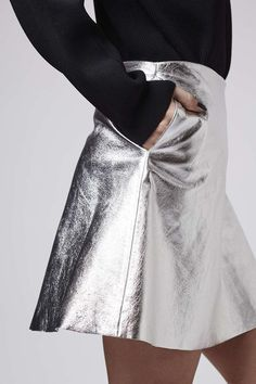 This metallic leather circle skirt by Boutique is perfect for the upcoming party season, and it matches Ines ' fingerless gloves in silver too! Mode Statements, Topshop, Metal Fashion, Body, What To Wear, Style Me, Womens Fashion, Fashion Trends, Winter Fashion