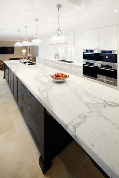 Supreme Kitchen Remodeling Choosing Your New Kitchen Countertops Ideas. Mind Blowing Kitchen Remodeling Choosing Your New Kitchen Countertops Ideas. Quartz Kitchen Countertops, Dark Kitchen Cabinets, Kitchen Countertop Materials, White Cabinets, White Granite Countertops, Kitchen Island, Calcutta Marble Kitchen, Cambria Countertops, Calcutta Nuvo