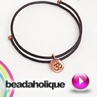 Tutorial - Videos: How to Use Rubber Cord and Memory Wire to Make a Charm Bangle | Beadaholique