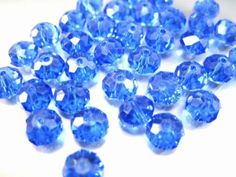 8MM Sapphire Blue Swarovski Crystal Faceted Rondelle Spacer Abacus Beads 10 pieces. $1.00, via Etsy.