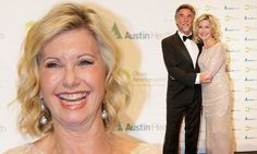 Olivia Newton-John cuddles up to husband John Easterling