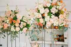 large stock and garden rose floral arrangements - love the pop of orange in this color scheme