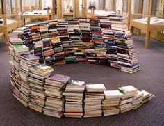 This would so cool to have in the my classroom. Get a buch of old cheap books at yard sales, hot glue them together, then you've gnot yourself a book nook. :) Perfect place for some plastic bean bag chairs and some reading! It wouldn't take tooo long ;)