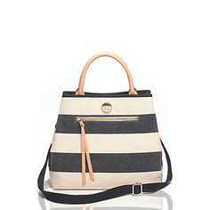 """Tommy Hilfiger women's handbag. Our summery twist on the shopper features sun-faded rugby stripes in canvas, plus a crossbody strap for hands-free toting.• Shopper silhouette in cotton canvas with gold-tone hardware and bonded leather trim. • Magnetic snap closure, front zip pocket, interior pockets, signature medallion on front.• 10.5"""" (H) 13"""" (L) 7"""" (W) 5"""" drop, adjustable shoulder strap drop.• Imported."""