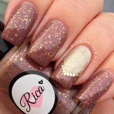 Up in the Attic custom hand crafted nail polish by justricarda.  warm brown crelly with rose gold shimmer to it. Up in the Attic has a lovely sprinkle of various gold/rose-gold glitters in it.