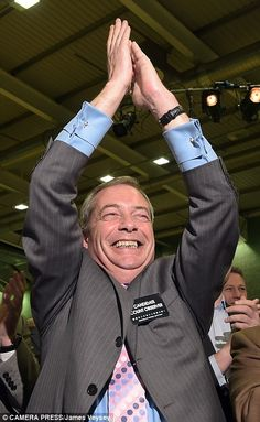 Nigel Farage celebrates as Mark Reckless of UKIP wins the Rochester and Strood parliamenta...