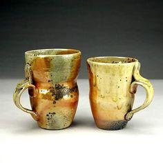 Aaron Moseley   Wood-fired, shino mugs.