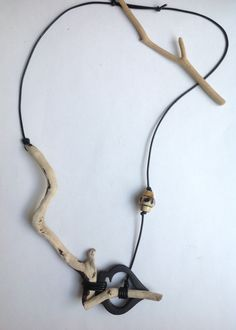 Necklacing with driftwood :-) and leather