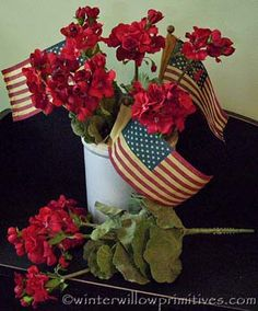 Red geraniums & flags, two of my favorite things