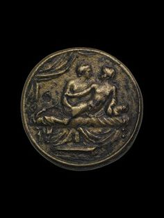 Ancient Rome coin/token used in brothels to pay prostitutes: Copper alloy spintria. Male lovers on bed. The eromenos (younger 'beloved', passive) is looking back at the erastes (older, active lover) and reaches back to hold his partner's upper arm. (reverse) XV within wreath.