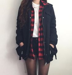 Flannel, black shorts, white tee, black utility jacket