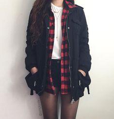 Flannel, black shorts, white tee, black utility jacket
