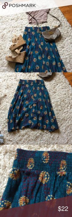 Gorgeous midi skirt Fun circle midi skirt in blue green with yellow detail. Thick waist band. Such a cute addition to your wardrobe. Dresses Midi