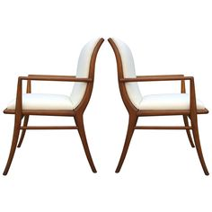 Pair Robsjohn-Gibbings Armchairs  USA  1950  Classic walnut sabre leg dining armchairs by T.H. Robsjohn-Gibbings. Dining table and set of six side chairs also available, as well as sideboard.