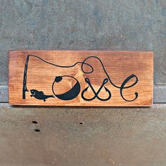 Handmade wooden sign, painted with fishing items that form the word LOVE. The wood has been stained and the saying has been painted in black . It measures 4.5x12. Each sign has a matte finish coating to protect it and comes ready to hang with a saw tooth hanger. ***PLEASE NOTE***