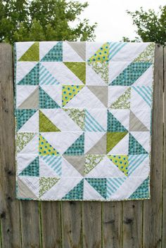 Triangle Baby Quilt The quilt details–all I did was use twelve 10″ squares of white and twelve 10″ squares of different patterned fabric (which includes Robert Kaufman, Alexander Henry, Riley Blake, Hobby Lobby, etc). I use THIS method for making four half square triangles at once.