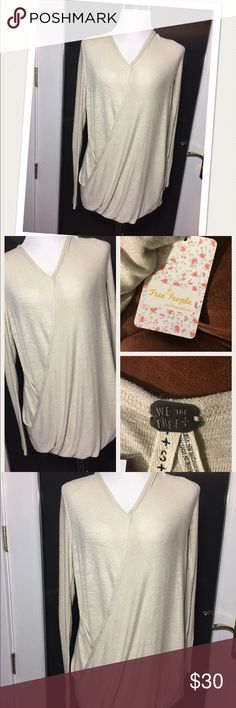 Free People drape shirt Free People super drape soft sweater! Size Medium, rayon and spandex. Such a beautiful sweater new with tags! Perfect condition natural slubs in fiber are part of the material. Free People brand Free People Sweaters V-Necks