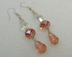 Swarovski peach earrings, sterling earwires. crystals. $18.00, via Etsy.
