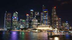 Singapura à noite, vendo-se o centro financeiro Raffles Place. - Wikipédia, a enciclopédia livre