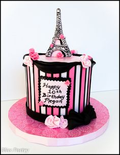 A pink and black Paris themed birthday cake