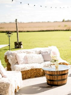 Use hay bales covered in cozy blankets, pillows or a few yards of lace as country-chic (but way less expensive) seating options for your ceremony and reception.