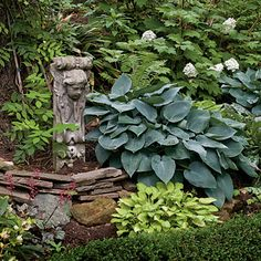 Accent your plantings with sculpture, posts, globes - whatever.  Shade garden with hostas, heuchers, ferns.