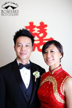 Wedding portrait after a traditional Chinese wedding tea ceremony. The bride is wearing a custom made qi pao dress. Photo by Bowerbird Photography. www.bowerbirdphotography.com