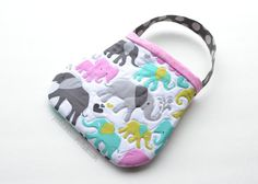 Yes, Elephants!  This sweet little purse will become your favorite toddlers most cherished gift.  Scrumptious fabrics and detailed quilting