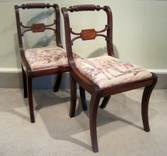 Pair of Regency Mahogany Side Chairs-A fine pair of Regency period solid mahogany side chairs with rope twist top rails, rosewood tablet backs and reeded sabre legs. Circa 1815. (Old upholstery).