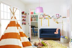 lots of great ideas in this playroom for M!  ADORE the little couch!