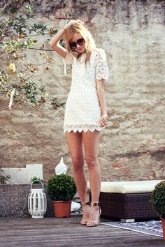white crocheted dress with gold accents