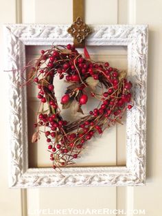 Valentines door decor. Wood be soooo cute with our white funky frame and red rose wreath! Come visit us at Rod Works!