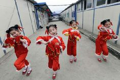 Chinese children dressed for a christmas parade