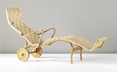 A rare wheeled version of BRUNO MATHSSON's Pernilla lounge chair.