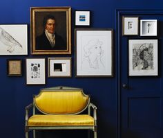 Like the rich dark blue paired with the yellow. Although I'm kind of over the accent wall as a thing, this works. The blue is Drawing Room Blue (253) from Farrow & Ball. As seen in the House & Home gallery of painted trim