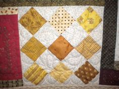 White Quilt with Yellow-Hued Pattern Diamond Blocks and Colorful Border or How to set quilt blocks on point