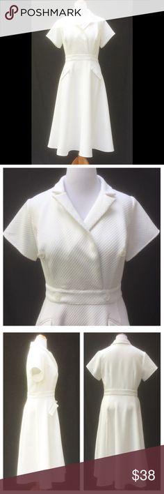 "New Eshakti White Fit & Flare Midi Dress 18W New Eshakti white jacquard fit & flare midi coat dress 18W Measured flat: Underarm to underarm: 42"" Waist: 38"" Length: 50"" Eshakti size guide for 18W bust: 45"" Surplice shirt collar, princess seamed bodice, side hidden zipper. Banded waist, front side flap pockets, button detail. Flared midi skirt. Polyester, textured woven jacquard, heavier weight, no stretch. Bodice lined in polytaffeta. eshakti Dresses Midi"