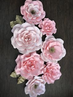 Pink paper flowers for a baby shower