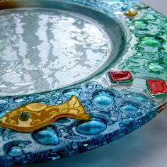 Colorful Fused Glass Dish by Fish-in-Glass, via Flickr