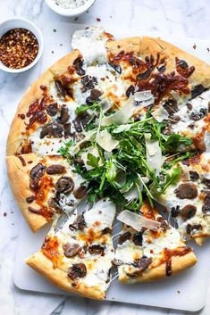 A simple mushroom and cheese pizza gets an upscale twist with truffled mushrooms and a light arugula salad topping one of the easiest homemade pizza doughs you can make. Mushroom Pizza Recipes, Truffle Mushroom, Vegan Truffles, Making Homemade Pizza, Truffle Recipe, Stromboli, The Fresh, Stuffed Mushrooms, Pizza
