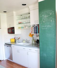 Groceries lists, the week's menu, reminders and save-the-dates can all be writ large on a chalkboard paint wall for everyone in the house to see.