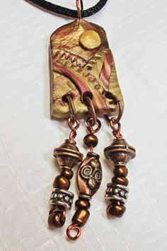 handmade bohemian polymer clay and beads mixed media by Bethville