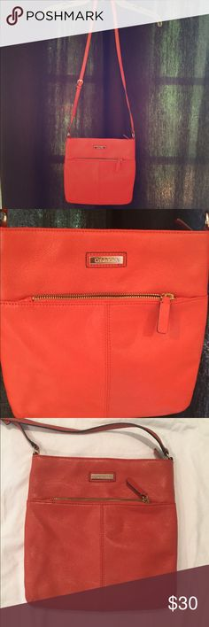 CALVIN KLEIN Orange crossbody Super cute bright orange Calvin Klein crossbody bag. A lot of space for being in the smaller side. Calvin Klein Bags Crossbody Bags