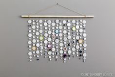 This many-mirrored wall hanging reflects more than just the light, it also reflects on-trend, modern style!